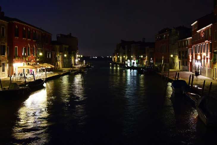 A canal in Venice, Italy at night on Saturday, June 11, 2016. The city of Venice is made up of over 100 islands sprinkled throughout the Venetian Lagoon located between the Italian mainland and the Adriatic Sea and are all connected by canals of varying sizes.